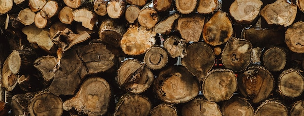 The sawn logs lie on top of each other. firewood for kindling. texture and background.