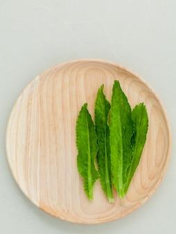 Sawtooth coriander leaf on white background.