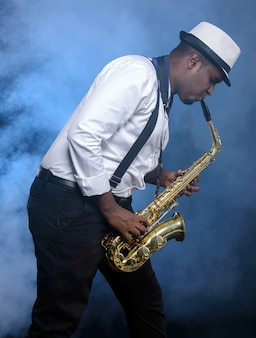 Saxophonist black men in white shirt