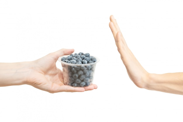 Say no blueberry in plastic container Premium Photo