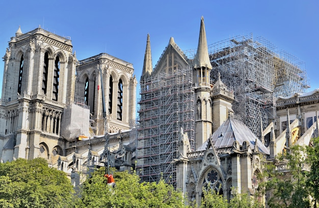 Scaffolding on the facade of the cathedral notre dame de paris after fire