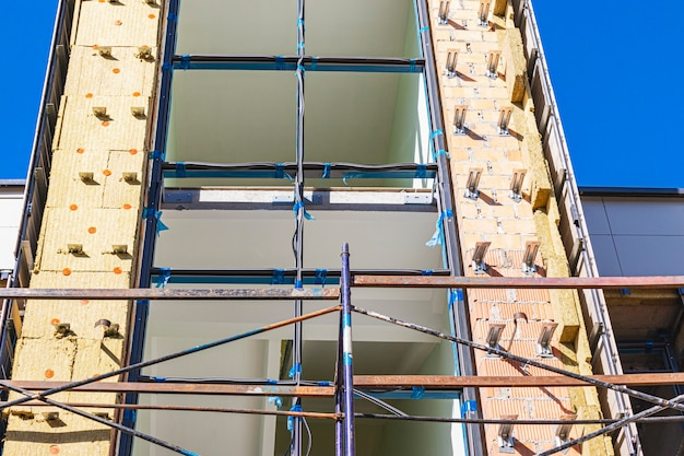Scaffolding and scaffolding with wooden decks, during the reconstruction of the building. performing construction work at height. construction safety.