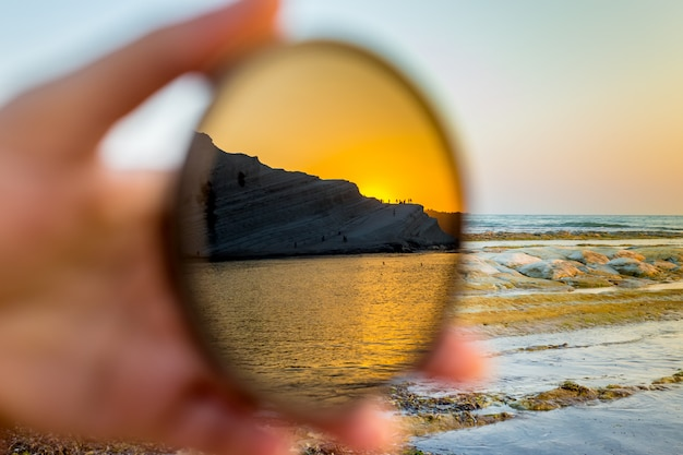 Scala dei turchi at sunset reflected on a filter for the camera