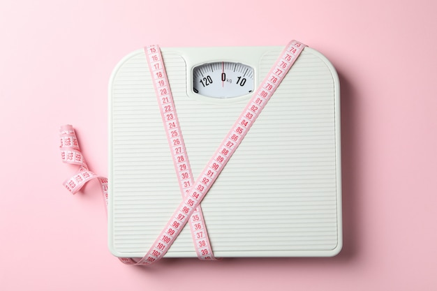 Scales and measuring tape. weight loss concept