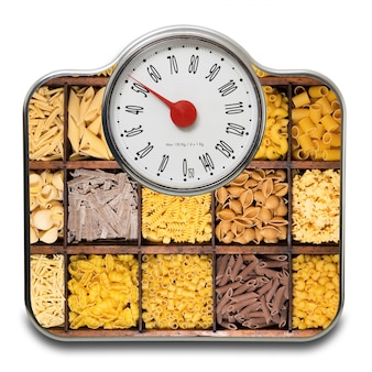 Scales for people with italian raw pasta on white