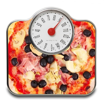 Scales for people with pizza on white