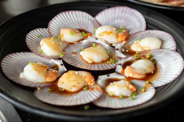 Scallop raw material sea food with ingredient seasonning cook