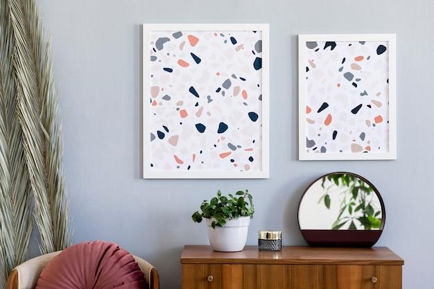 モックアップポスターフレームとアクセサリーとリビングルームのインテリアデザインのスカンジナビアのコンセプト