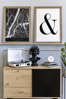 Scandinavian interior of living room with mock up poster frame vinyl recorder and accessories