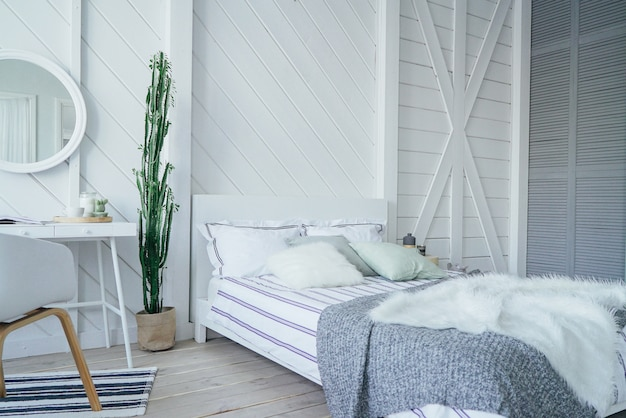 Scandinavian modern cozy eco interior, white table and mirror in bed room