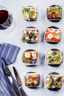 Scandinavian snack. smorrebrods. traditional danish open sandwiches, dark rye bread