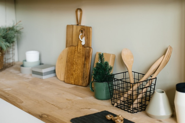 Scandinavian style kitchen utensils wooden cutting boards wooden spoons and shovels