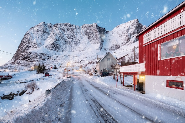 Scandinavian village with snowing and snow mountain at lofoten