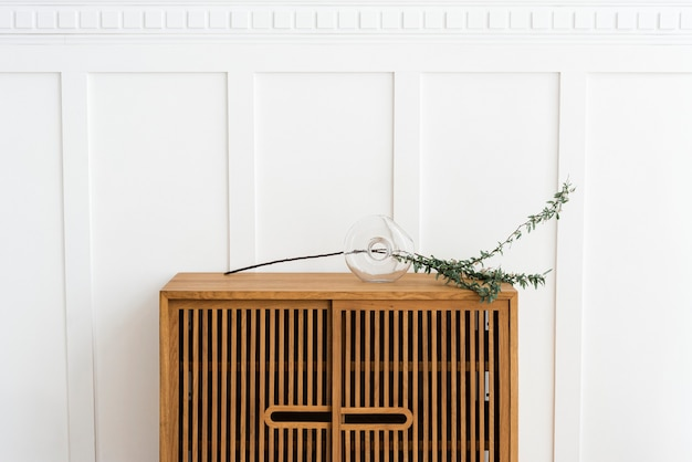 Scandinavian vintage wood cabinet by a white wall