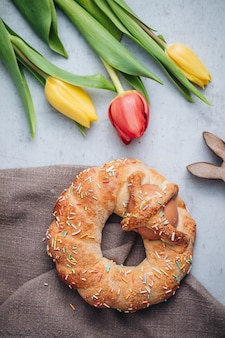 Scarcella, a traditional pastry for easter holidays in puglia region with colorful tulips