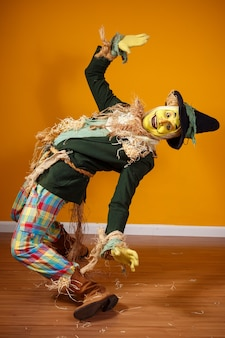 Scarecrow character from festa junina on yellow wall
