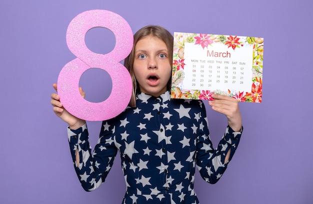 Scared beautiful little girl on happy women's day holding calendar with number eight around face