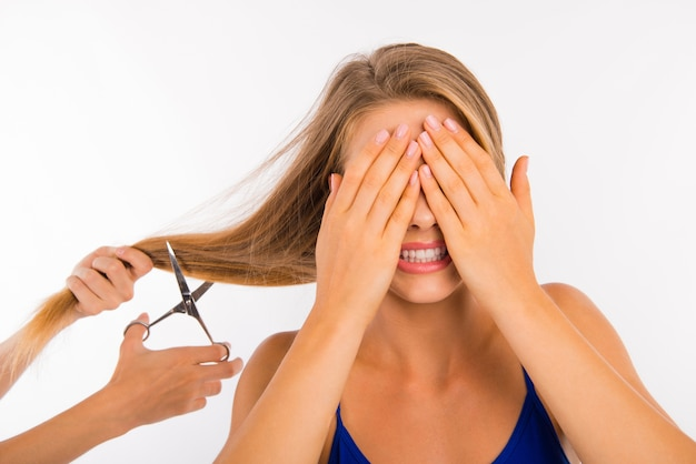 Scared disappointed woman going to cut her split ends