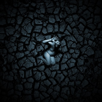 Scared naked man on the cracked soil