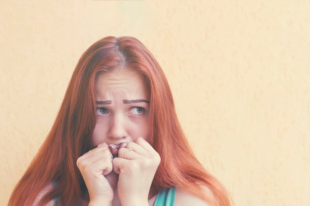 Scared red-haired woman