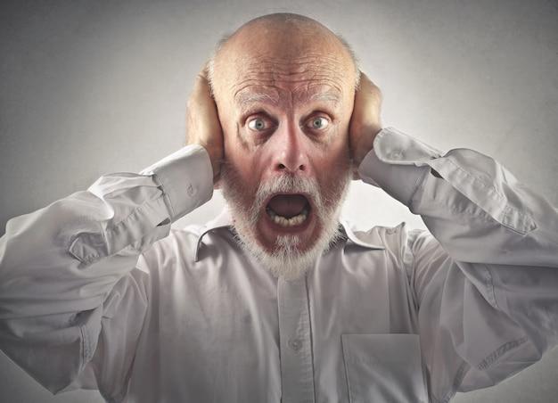 Scared shocked senior man