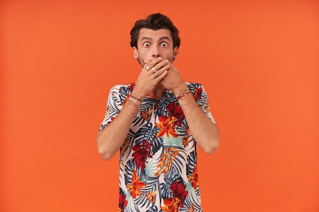Scared shocked young man with bristle in colourful shirt c