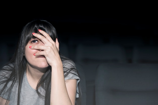 Scared woman in cinema