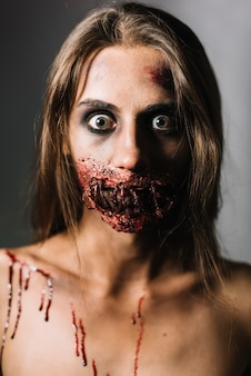 Scared woman with damaged face