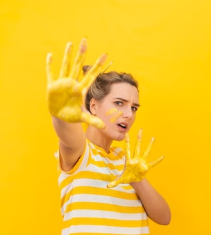 Scared woman with painted hands