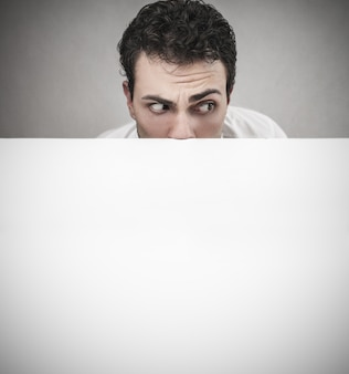 Scared worried man with blank white background