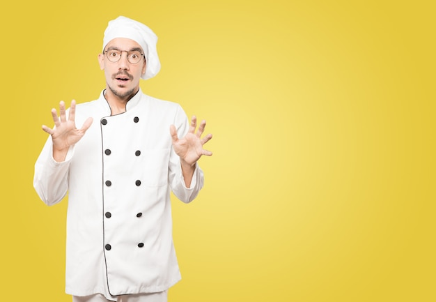 Scared young chef screaming