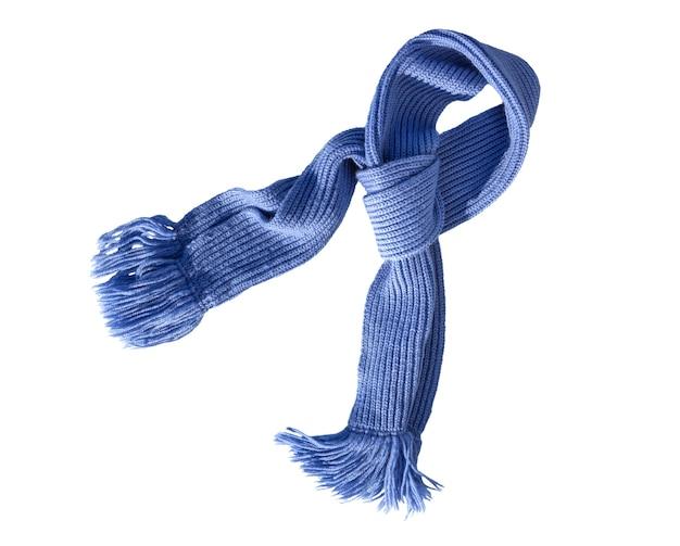 白い背景にフリンジ付きのスカーフニット手仕事。カラフルなウールのスカーフ。