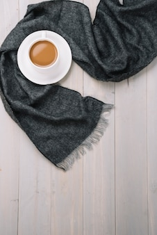 Scarf near cup of drink