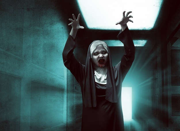 Scary asian nun with bloody mouth raise up hand
