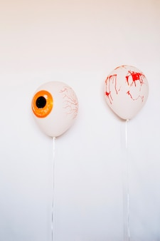Scary balloons with blood on white wall