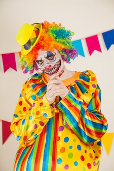 Scary clown for halloween. violence and childhood fear