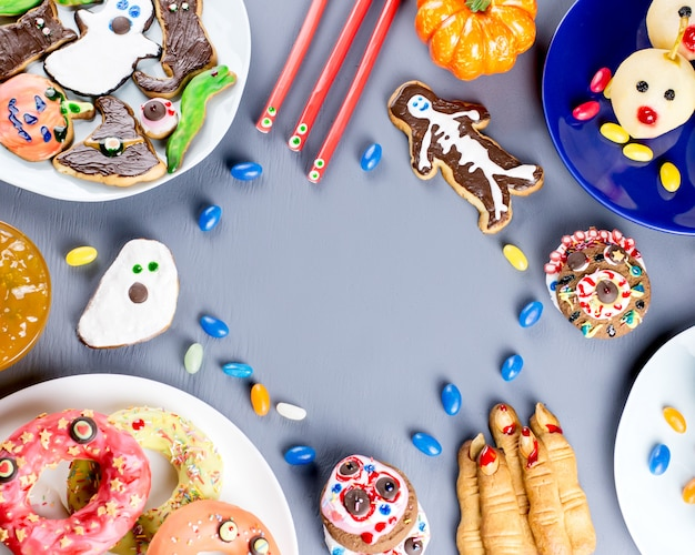 Scary cookies, monster biscuits and fruits for halloween holiday