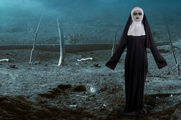 Scary devil nun standing with a night scene background