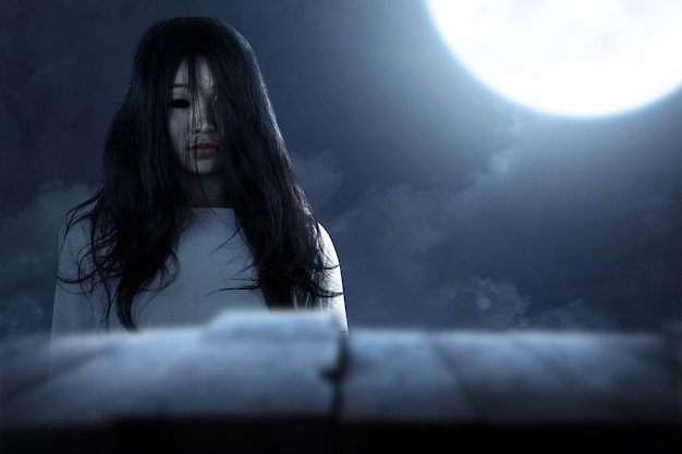 Scary ghost woman standing with night scene background. halloween concept