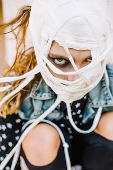 Scary girl with bandaged face