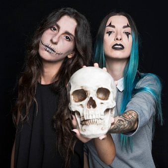 Scary girls with human skull