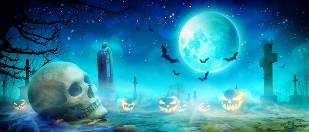 Scary halloween night with scull and crow in the graveyard.
