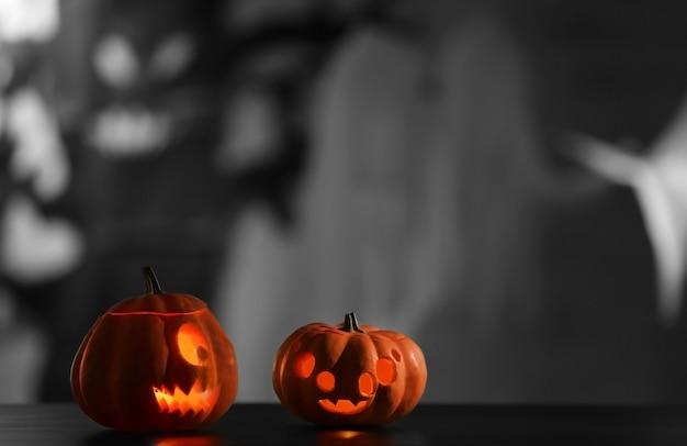 Scary halloween pumpkins on blurred