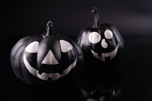 Scary halloween pumpkins isolated on black. scary faces trick or treat