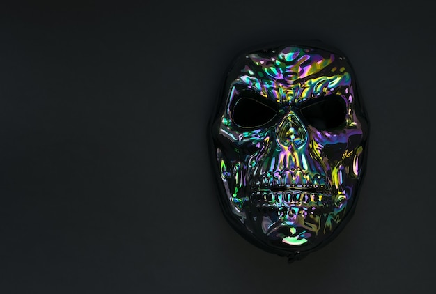 Scary mask in the form of a skull on black