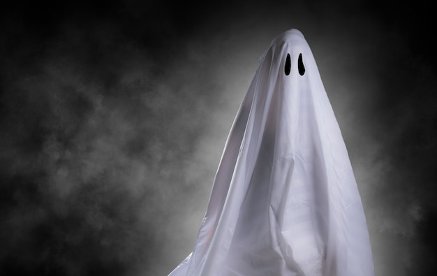 Scary white ghost at big eye for halloween concept with clipping path