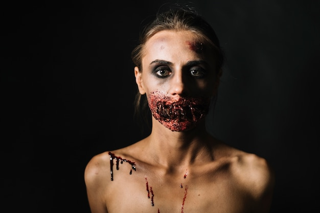 Scary woman with damaged face