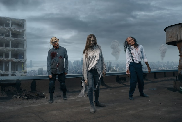 Scary zombie army on the roof of abandoned building, deadly chase. horror in city, creepy crawlies attack, apocalypse