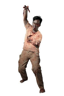 白い背景の上に孤立して立っている彼の体に血と傷を持つ怖いゾンビ