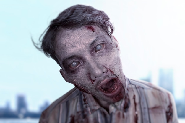 Scary zombie with blood and wound on his body standing